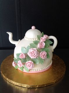 The pink sugar flowers and fondant leaves really set off this fondant covered tea kettle