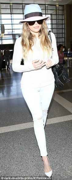 Wedding bound: The 29-year-old Khloe Kardashian wore a white sweater, light blue skinny jeans and white stiletto heels