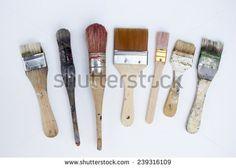 Used artist brushes on white canvas - stock photo