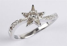 Ladies` star shaped diamond ring, comprising brilliant cut central stone surrounded by five trian