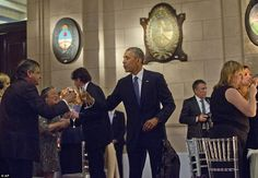 Obama toasts guests at theCentro Cultural Kirchner during a state dinner as part of a two...