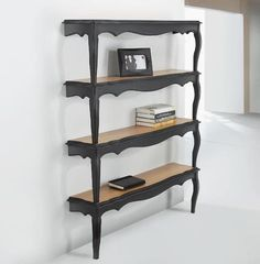Cut coffee tables and then stack them against the wall for funky shelving.  Cleverly recycled.