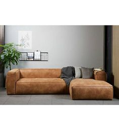 Corner sofa Bean from WOOOD. This sturdy and comfortable sofa is finished with recycle leather and has a brown cognac look. This bank is available in a left . Chaise Sofa, Reclining Sofa, Chair Cushions, Canapé D'angle But, Living Room Sofa, Living Room Decor, Canapé Angle Convertible, Long Sofa, Canapé Design