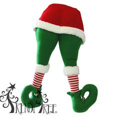 """Plush Elf Butt and Legs Size: 20"""" x 9.5"""" (hook on back 11.5"""") Material: Synthetic Plush Not a toy; not made for children. Color: Red, Green White with striped legs."""