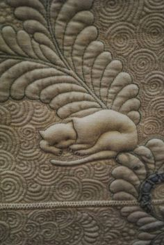 "from TEN CAT GARDEN by MING HSU of Australia - a finalist in Australasian Quilt Convention challenge ""TEN"" - Wholecloth quilt using vintage floral tablecloth, with ten quilted cats hidden throughout the free-motion quilting. More detail shots, and others from the exhibit, at link. Less virtuoso quilters like me: Think animal line art, an extra layer of batting under that motif, with dense quilting in the background. Image search MING HSU QUILT for much more free-motion goodness!"