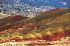 Painted Hills, Oregon  years of erosion have exposed the multicolored minerals that formed the hills. The area also contains extraterrestial-looking volcanic formations and fossils from ancient and extinct creatures