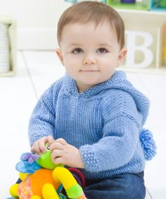 Knit this simple pullover for your favourite little one! The attached hood looks cute up or down and gives mum one less thing to worry about.