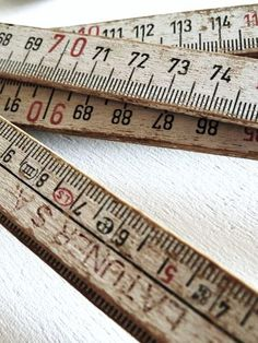 old wood measuring sticks