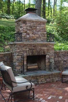patio with outdoor fireplace. natural stone around the fire and ... - Patio Ideas With Fireplace