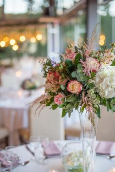 Retro classic wedding table decoration with tall vase flower arrangements in shades of pink and white at Alsos Nimfon Flower Vases, Flower Arrangements, Flowers, Wedding Decorations, Table Decorations, Tall Vases, Wedding Table, Shades, Retro