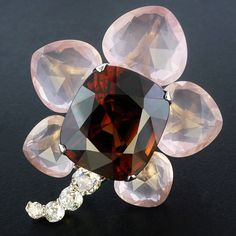 Taffin, Giant zircon, Madagascar pink quartz and old mine diamond flower brooch.