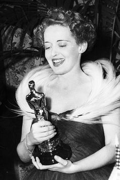 Image result for vintage bette davis getting oscar in color