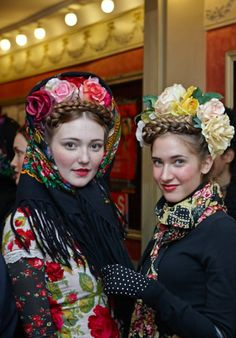Models backstag in ethnic, tirbal inspired spring fashion. Flower crown and black lace to match