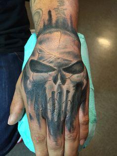 Punisher skull on top of hand tattoo by Spirits in the Flesh tattoo studio S.F www.spiritsinthefleshtattoo.com