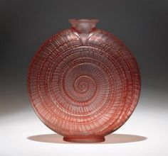 Made by René Jules Lalique (1860-1945)  The glass vase is patinated in crimson red to striking affect.