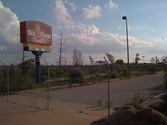The sign at the entrance to this Six Flags park in New Orleans still reads CLOSED FOR STORM all these years later, serving as a reminder of the tragedy that caused the park to close.