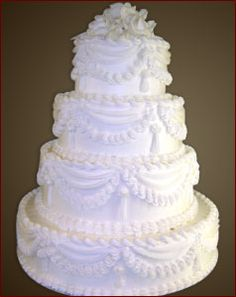 old fashioned wedding cakes pictures   Decked with roses and babies     A traditional 4 tier white buttercream wedding cake with draping cream  accents