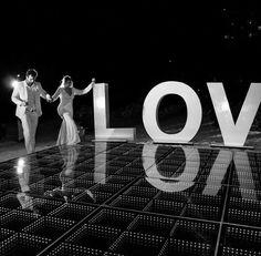 L O V E  ever after at Dreams Sands Cancún #lightdancefloor #dinnerarea #weddingreception #firtsdance #loveisintheair