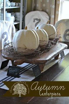 Autumn Centerpieces with natural elements... White pumpkins, or painted white, with wild grape vines.
