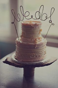 DIY wire cake topper. /////  Is it just me, or does this look like We lol? If thats the case, maybe its not such a good topper for a wedding cake.