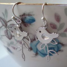 Not actually flowers but still gorgeous    Small Bird & Silver leaf dangly earrings by ABoxForMyTreasure, €12.00