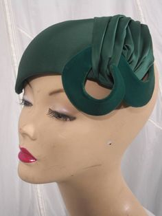 1950s Scuplted Sea Green Satin Hat | From a collection of rare vintage hats at https://www.1stdibs.com/fashion/accessories/hats/