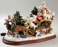 """You can never have too many """"elves""""  lol!  This is by Danbury Mint...Westie Christmas Sleigh."""
