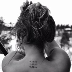 A tattoo with meaning. The numbers are the three dates she beat cancer.