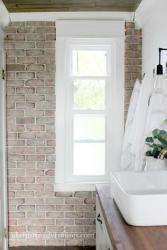 Everything you need to know about how to install brick veneer in your home, and where to buy it. Perfect DIY tutorial for an accent wall in your home decor.