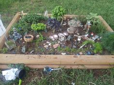 My herb garden transformed into a fairy garden. My granddaughters are the cheif architects and designers. They spend hours playing :)