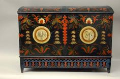 Large trunk with Vest-Agder style rosemaling on front panel and lid. Interior is unpainted.