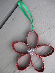 TP Christmas flowers - take a toilet paper roll holder and cut in five equal pieces. Cover with mod podge or glue and coat in red glitter. Glue or stitch together and glue on three beads. Make two holes for ribbon to loop through.