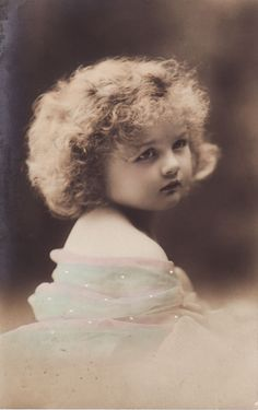 Vintage Images........pretty baby, I can't but wonder what's on her mind.....