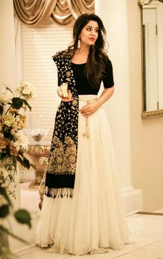 Black dupatta with simple black top and white skirt