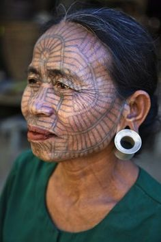 Myanmar | A Chin woman with tattooed face. Girls used to be tattooed at the age of 14 or 15 years. Panbaung Village, Chin State | © Nigel Pavitt