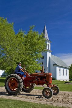 God Bless the Farmers of America (05-14-13 JFB: Daddy had a red Farmall tractor. I miss Daddy SO MUCH!)