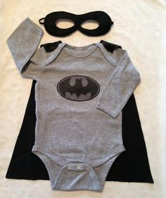 Baby Batman Halloween Costume -- or change the colors and logo for Superman--in no way do I desire children any time soon but couldn't help but post this in case people with similar interests who were having kids liked this :) it is pretty awesome