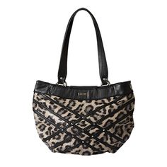The Jenna for Demi Miche Bags has sex appeal that really purrs! Ebony and creamy-taupe leopard-print faux leather is accented with criss-crossing strips of black on the front along with tiny rivets in all the right places. You'll feel powerful and fierce with this feline confection on your arm. Back zippered pocket with oval bottom design. *Miche Canada* #miche #michecanada #michefashion #fashion #style #purses #handbags #accessories