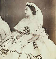 Photograph of Princess Victoria in her wedding dress, 25 January 1858. Three-quarters length portrait, seated, turned to her right. From a daguerreotype taken just before the marriage.