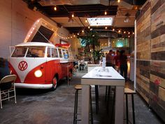 Tacombi   Manhattan. Cute idea with the VW. if the garage is converted into a visitor center this would be a cute idea. VW serves tacos, another stand for drinks, free wifi, and a Netflix movie playing.