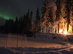 Relax by a warm fire while you watch the aurora dance across the northern sky