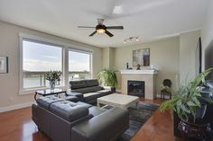 Gorgeous Family Home on Kinniburgh Pond in Chestermere!  A room with a view! MLS: C4103671