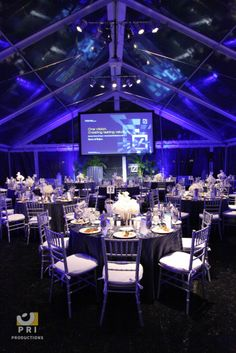 The purple and blue LED lights create the perfect ambiance under this clear tent.