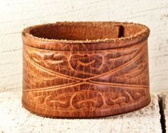 This Leather Cuff Wristband is Handcrafted from an Old Vintage Belt. Leather is Hand Tooled, Hand Painted, and OOAK - One of a kind.    • Will fit a SMALL Womens wrist comfortably.  • When snapped the inside of cuff measures 6.  • The width is 1 1/4.    * For info on Wrist Measurements & Cuff Sizing - see my Shop Policy Page:  http://www.etsy.com/shop/rainwheel/policy    === Click here to see all of my Leather Cuffs ===  http:&#x...