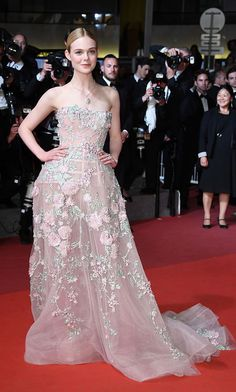 More like pink angel. Neon Demon actress Elle Fanning made a floral statement on the carpet of her Cannes Film Festival screening.