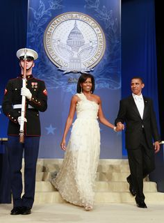 At the Southern Inaugural Ball on January 21, 2009, in Washington, DC, Michelle wore a dress designed by Jason Wu, who did not know that Michelle had chosen his design to wear. Wu designed the dress to symbolize hope; its organza flowers are adorned with Swarovski crystals.