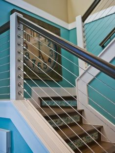 Here's a closer look at the great stair railing.  I really like this modern look.  Read more: http://www.addicted2decorating.com/come-tour-the-2013-hgtv-smart-home-with-me.html#ixzz2TPjjYbMR