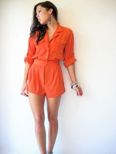 1980's Vintage Bright Orange Romper / Military Jumpsuit Shorts / Tab sleeves. $28.00, via Etsy.
