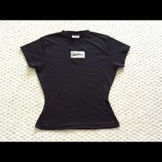 NEW Reebok Black Workout Tee Never worn - black Reebok workout t-shirt 100% nylon stretch. Reebok Tops