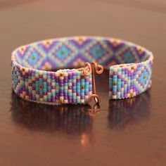 Tribal Diamonds Bead Loom Bracelet Southwestern Native American Inspired Boho Bohemian Purple Beaded Stocking Stuffer Artisanal by PuebloAndCo on Etsy https://www.etsy.com/listing/195501571/tribal-diamonds-bead-loom-bracelet